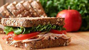 Картинка Бутерброды Вблизи Помидоры Ветчина Хлеб Сэндвич