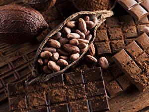 Картинка Сладости Шоколад Орехи Шоколадная плитка Какао порошок Еда