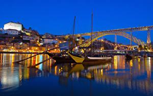 Картинки Португалия Портус Кале Дома Река Мосты Причалы Речные суда Вечер Города