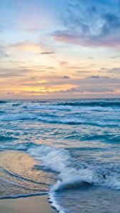 Фото Мексика Море Побережье Волны Рассвет и закат Cancun Природа