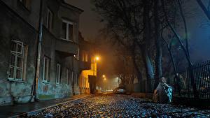 Фотография Польша Варшава Дома Улица Ночь Уличные фонари Ограда Города