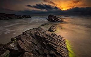 Обои Болгария Море Рассвет и закат Камень Берег Облака Природа