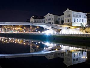 Фото Испания Здания Мосты Ночь Отражение Уличные фонари Водный канал Bilbao Basque Country Города