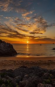 Картинка Рассвет и закат Пейзаж Море Небо Солнца Пляжа Облачно