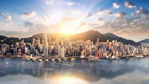 Картинка Китай Гонконг Здания Пирсы Горы Море Лучи света Города