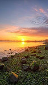 Обои для рабочего стола Ирландия Побережье Камни Рассвет и закат Солнце Kinvara Природа