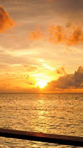 Фото Мальдивы Море Рассветы и закаты Небо Облака