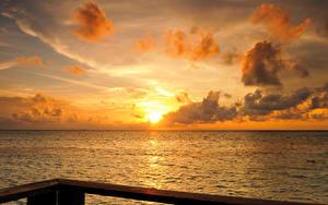 Фото Мальдивы Море Рассветы и закаты Небо Облако Природа