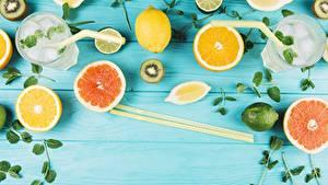 Обои Цитрусовые Лимоны Грейпфрут Палочки для еды Стакан Доски Еда