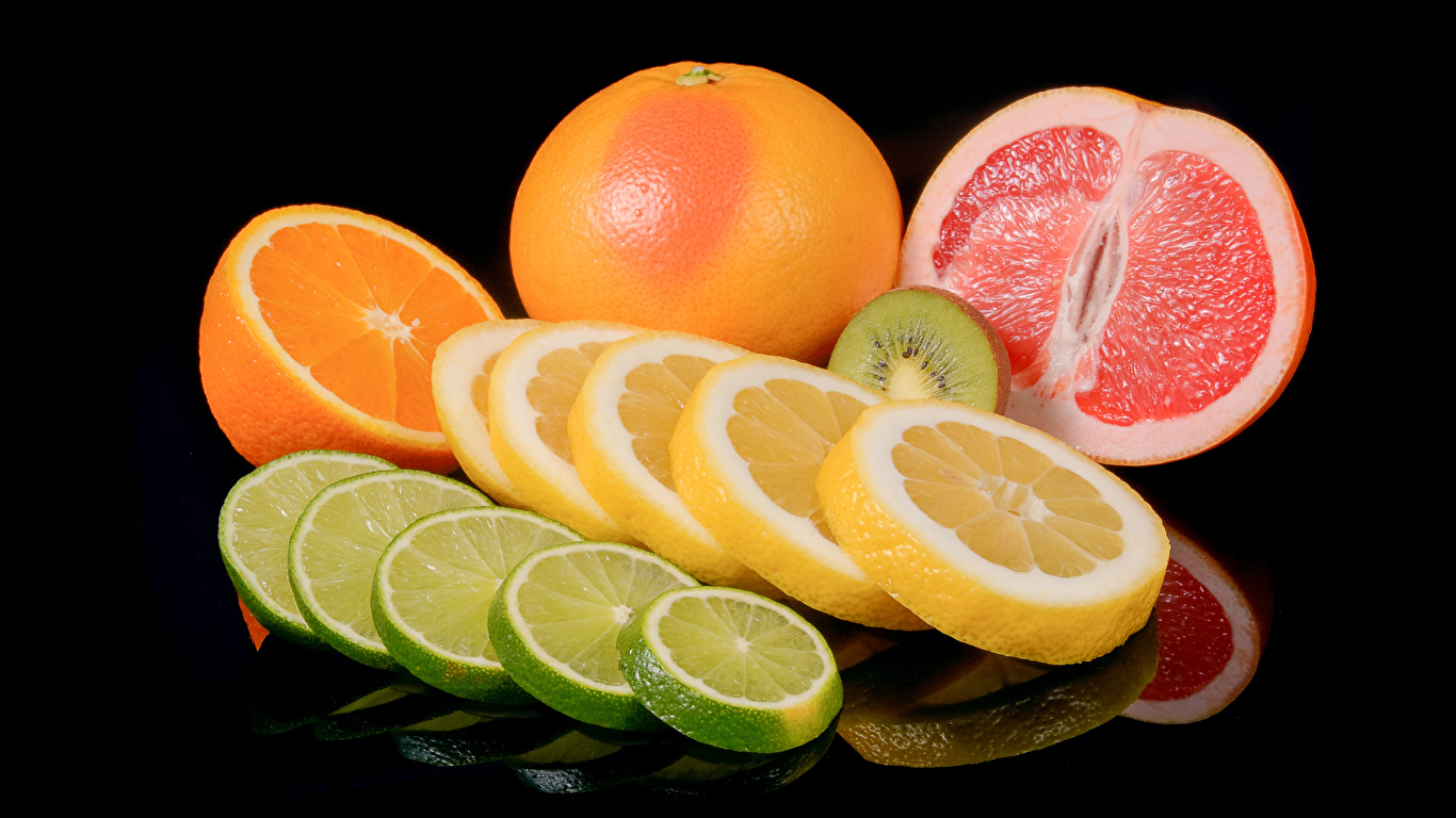 Фото Апельсин Грейпфрут Лимоны Пища Цитрусовые на черном фоне 1366x768 Еда Продукты питания Черный фон