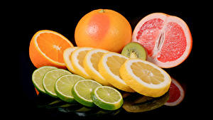 Фото Цитрусовые Лимоны Апельсин Грейпфрут Черный фон Еда