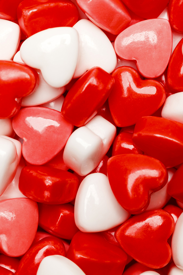 Картинка День святого Валентина Сердце Леденцы Продукты питания Сладости 640x960 День всех влюблённых серце сердца сердечко Еда Пища