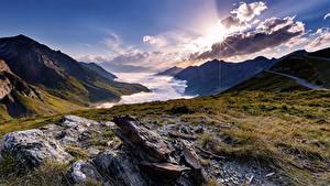 Картинка Франция Рассветы и закаты Гора Камни Пейзаж Облачно La Mongie Midi-Pyrenees
