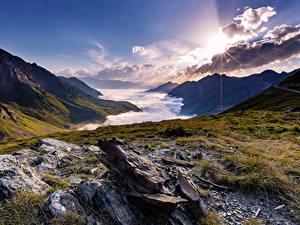 Картинка Франция Рассветы и закаты Гора Камни Пейзаж Облачно La Mongie Midi-Pyrenees Природа