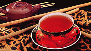 Картинки Напиток Чай На черном фоне Чашка Блюдце Еда