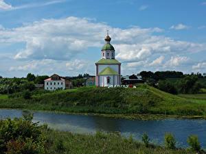 Обои для рабочего стола Россия Река Церковь Холмы Suzdal Vladimir Oblast Города