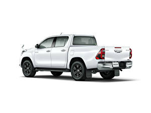 Картинки Toyota Пикап кузов Белый Металлик Белым фоном Hilux Z Double Cab, JP-spec, 2020 машины