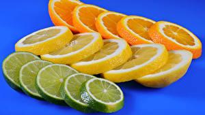 Картинка Цитрусовые Лимоны Апельсин Цветной фон Нарезанные продукты Продукты питания