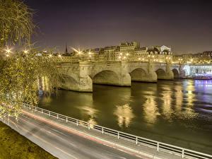 Картинка Франция Здания Речка Мосты Дороги Париж Ночью Города