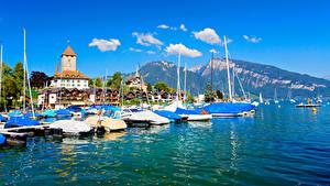 Картинки Швейцария Горы Здания Озеро Пристань Thunersee Thun