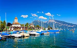 Картинки Швейцария Гора Здания Озеро Пристань Thunersee Thun Города