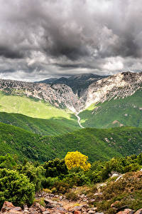 Картинки Италия Гора Небо Пейзаж Кусты Облака Canyon Gorropu Природа