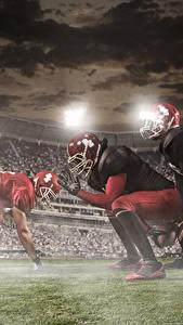 Фото Мужчины Американский футбол Втроем Униформа Шлем Спорт