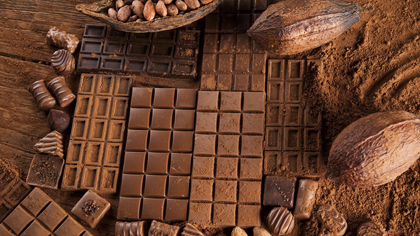 Картинка Какао порошок Шоколад Шоколадная плитка Орехи Сладости 1366x768 шоколадка сладкая еда