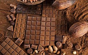 Картинка Сладости Шоколад Орехи Шоколадка Какао порошок Еда
