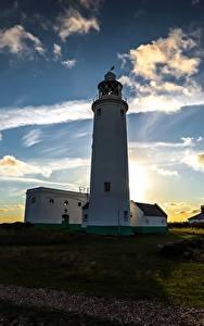 Картинки Рассветы и закаты Небо Берег Маяки Природа