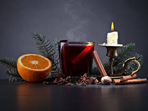 Картинки Рождество Свечи Апельсин Бадьян звезда аниса Корица Напитки Ветки Стакана Еда