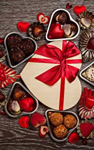 Картинка День святого Валентина Сладости Конфеты Шоколад Подарок Сердца Бантик