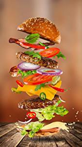 Фотография Быстрое питание Гамбургер Булочки Овощи Мясные продукты Доски Еда