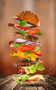 Фотография Быстрое питание Гамбургер Булочки Овощи Мясные продукты Доски