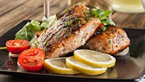 Фотографии Рыба Лимоны Томаты Пища