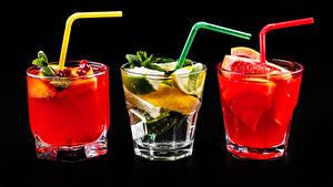 Картинки Алкогольные напитки Коктейль Цитрусовые Черный фон Трое 3 Рюмка Стакан Пища