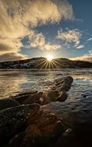Картинки Небо Норвегия Облако Солнце Лучи света Troms