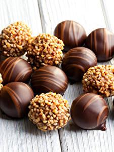 Картинка Сладости Конфеты Шоколад Доски Пища