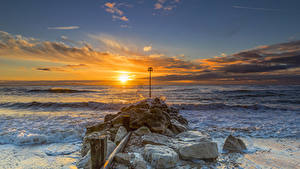 Фото Англия Море Рассветы и закаты Камень Небо Волны Облака Christchurch Природа