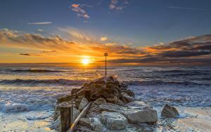 Фото Англия Море Рассвет и закат Камень Небо Волны Облако Christchurch Природа