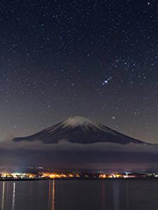 Картинки Япония Небо Звезды Фудзияма Ночь Вулканы Природа