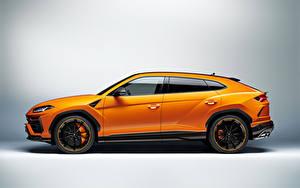 Фотографии Lamborghini Оранжевые Металлик CUV Сбоку Urus Pearl Capsule 2020 авто
