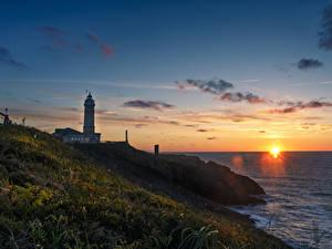 Фотография Испания Берег Рассвет и закат Маяки Трава Santander Cantabria