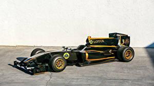 Обои для рабочего стола Лотус Формула 1 Черный 2010-11 T125 Exos автомобиль