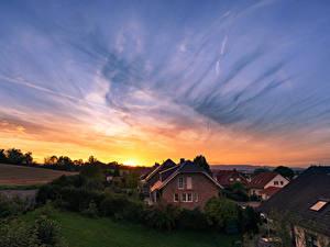 Фото Германия Дома Рассветы и закаты Кусты Города