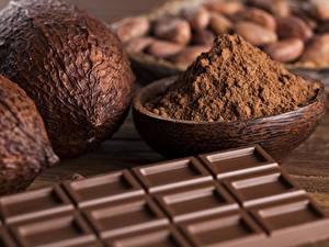 Картинки Шоколад Вблизи Орехи Шоколадка Какао порошок Еда