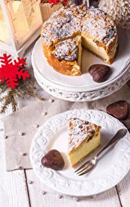 Фотография Рождество Пирог Тарелка Снежинки Вилка столовая Кусок Продукты питания