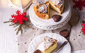 Фотография Рождество Пирог Тарелке Снежинки Вилка столовая Кусок Продукты питания