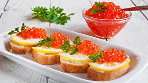 Картинка Бутерброды Морепродукты Икра Лимоны Пища