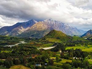Картинки Новая Зеландия Горы Поля Луга Деревья Облачно Queenstown Природа